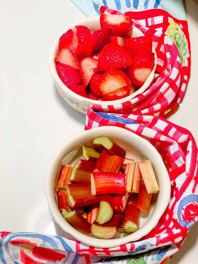 Cut Strawberry & Rhubarb In Bowls. The sour but sweet love story between strawberry and rhubarb –